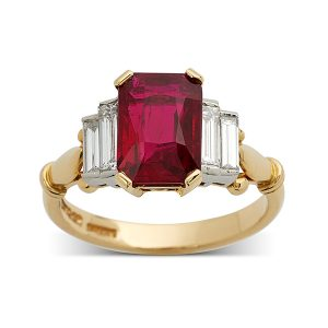 Emerald-cut-ruby-with-stepped-baguette-diamonds