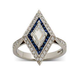 Lozenge-shaped-central-diamond,-calibre-cut-sapphires