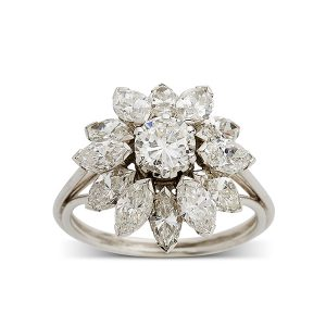 Oval-central-diamond-with-marquise-cluster-surround
