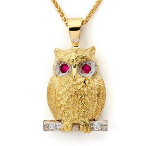 Owl-pendant-with-diamonds-set-to-branch,-diamonds-surrounding-ruby-eyes