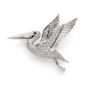 Pelican-in-flight-with-diamonds